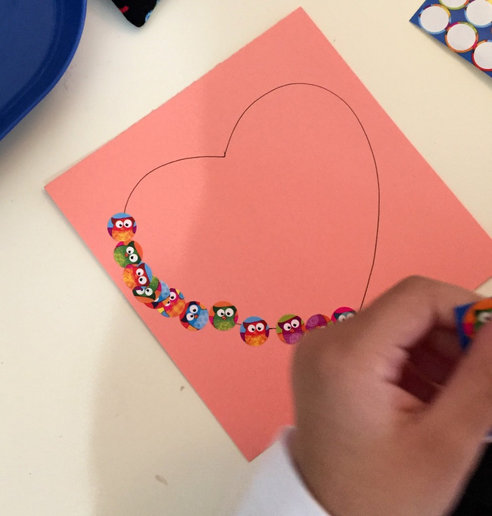 Valentine Shelf Activity-Stickers on a heart