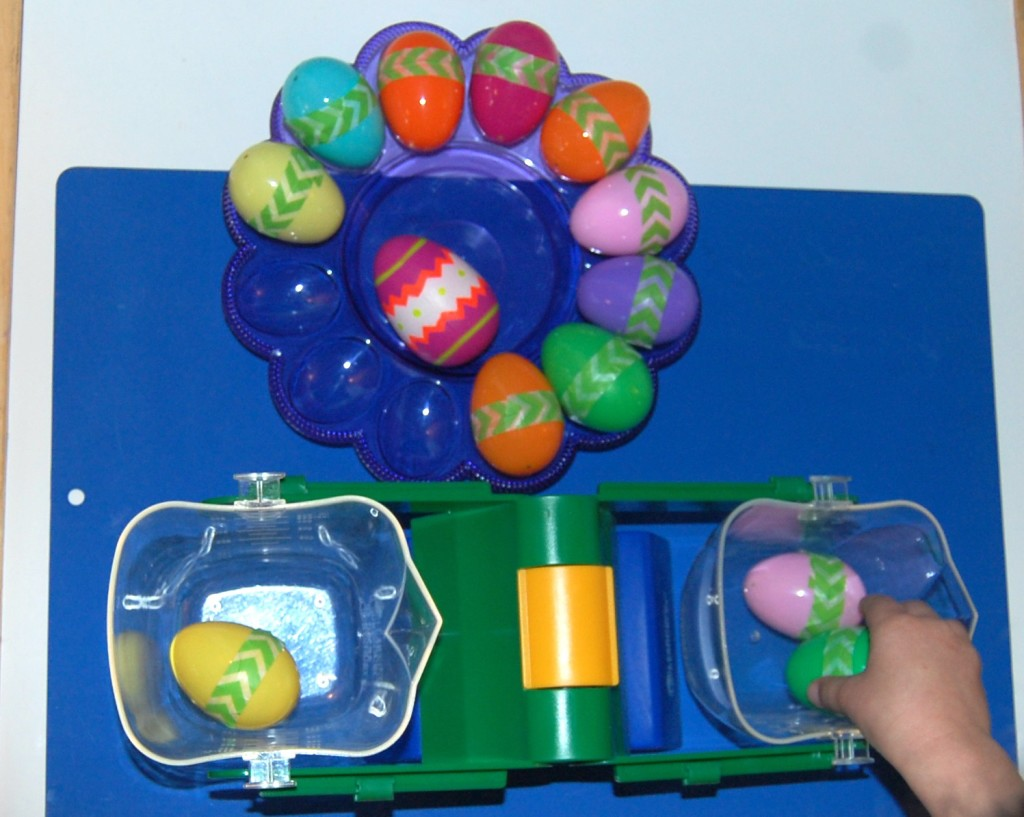 Easter Projects for Preschoolers - Scale weighing plastic eggs