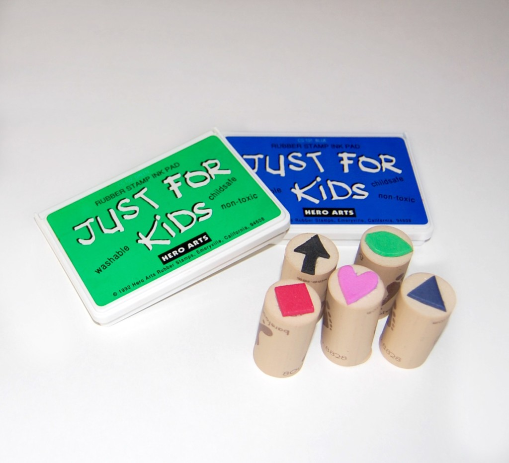 Make your own stamps using foam sheets, wine corks and a hot glue gun.