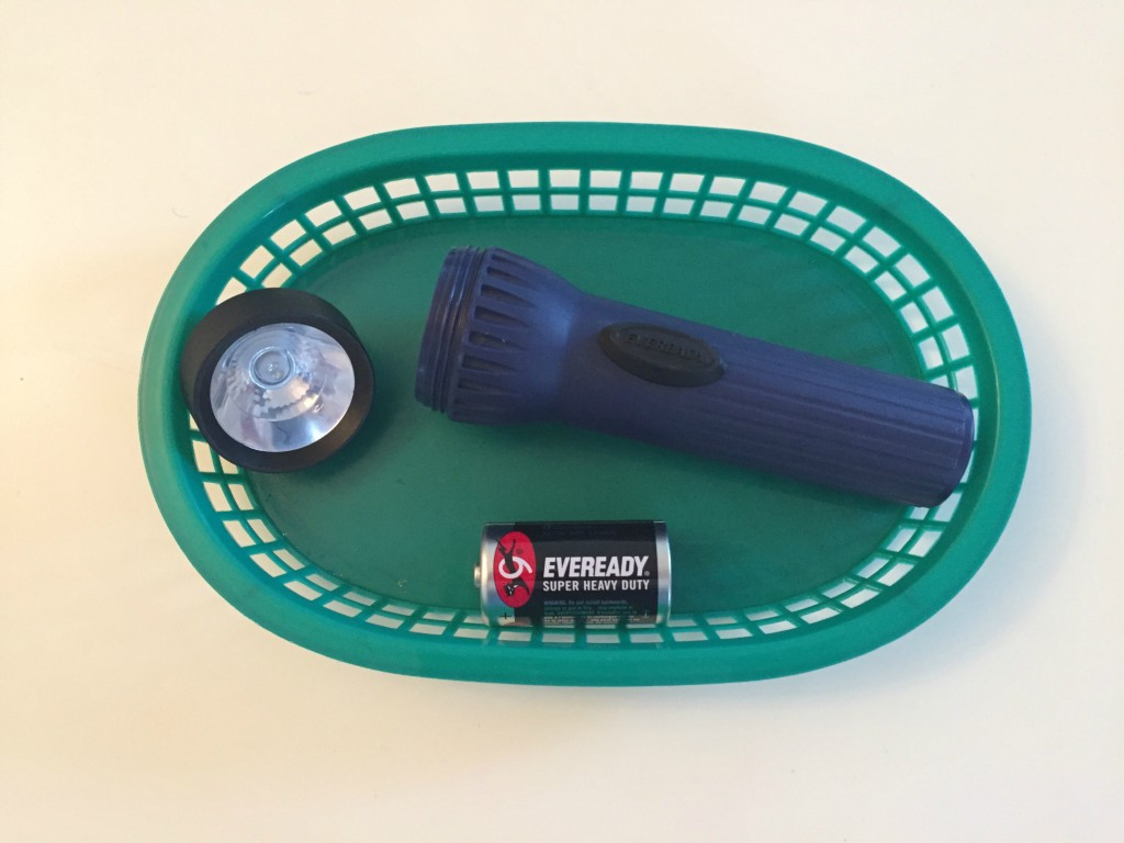 Practical Life Shelf - Putting together a flashlight