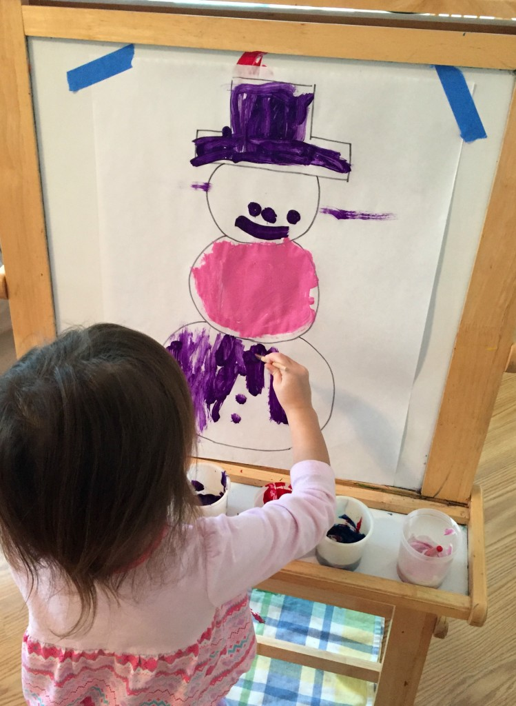Painting Snowmen at the easel